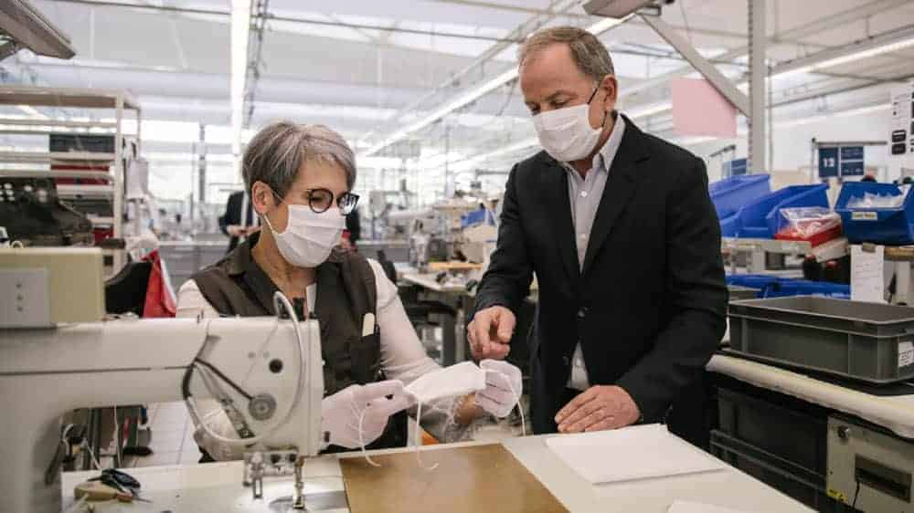 Luxury fashion giant Luis Vuitton tailors free medical gowns